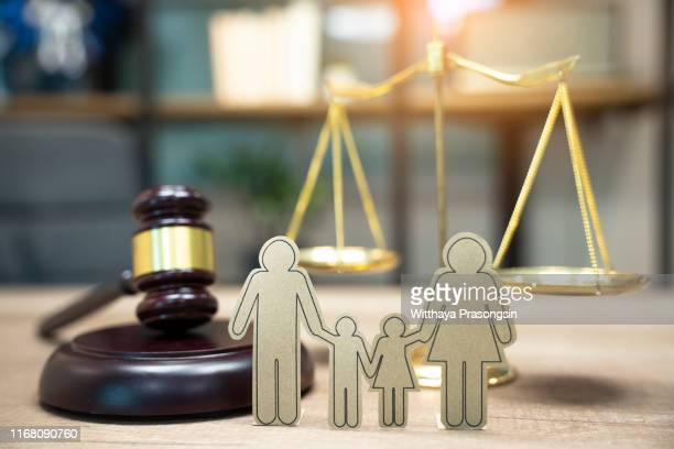 family figure and gavel on table. family law concept - family politics stock pictures, royalty-free photos & images