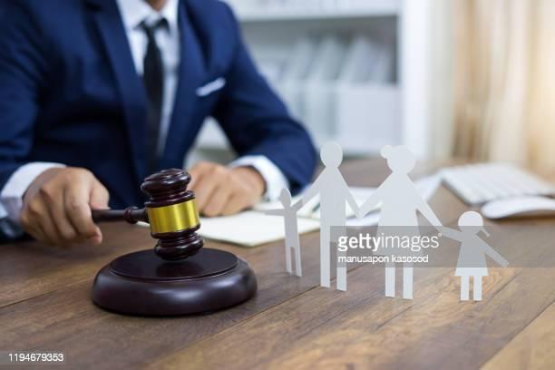 family figure and gavel on table. family law concept - legislação - fotografias e filmes do acervo