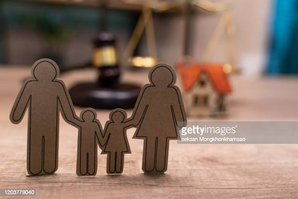 family figure and gavel on wooden table. family law concept - divorce kids stock pictures, royalty-free photos & images