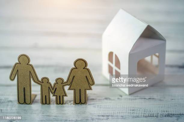 family figure with a house - house icon stock pictures, royalty-free photos & images