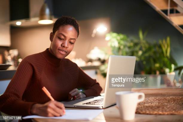 family finance working from home. - author stock pictures, royalty-free photos & images