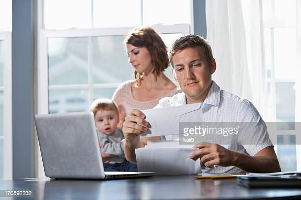 family finances - open grave stock photos and pictures