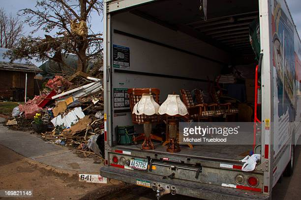 Family finds a few things that escaped damage as Moore, Oklahoma tries to recover after tornado on May 20, 2013.