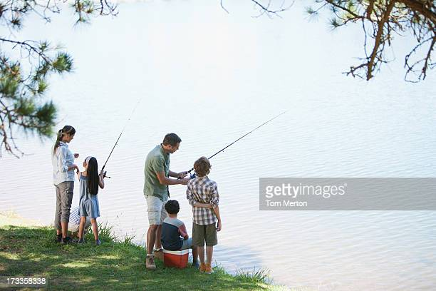 family fishing lakeside - fishing stock pictures, royalty-free photos & images