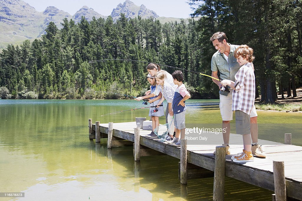 Family fishing off dock : Stock Photo