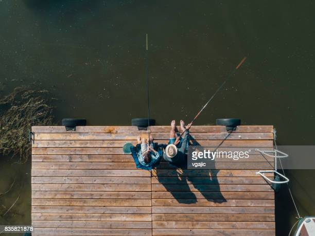 family fishing on jetty - jetty stock pictures, royalty-free photos & images