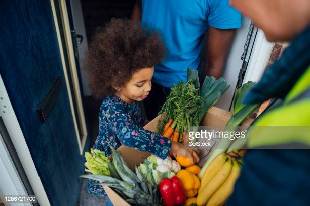 family food delivery - charity benefit stock pictures, royalty-free photos & images