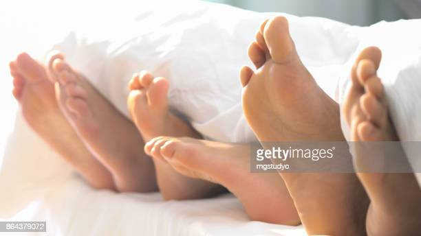 Family foot in Bed have Fun Sunday Morning