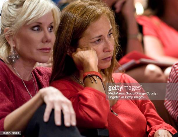 Family friend Laurany Gergen left sits by Nanci Macleod mother of Tyler as they listen to family members speak before the Huntington Beach City...
