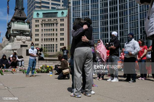 Family, friends and communitys members attend a vigil in Indianapolis, Indiana on April 18, 2021 to remember the victims of a mass shooting at a...