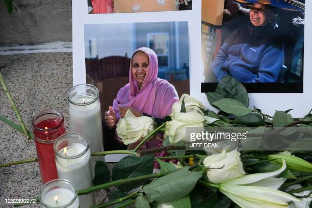 Family, friends and communitys members lay flowers and candles during a vigil in Indianapolis, Indiana on April 18, 2021 to remember the victims of a...