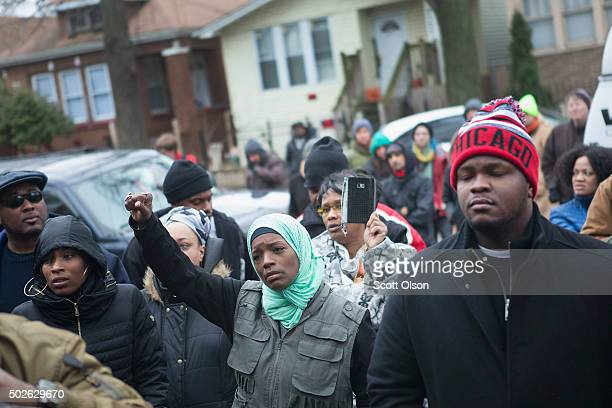 Family friends and supporters gather outside the home of Bettie Jones and Quintonio LeGrier during a vigil on December 27 2015 in Chicago Illinois...