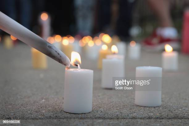 Family friends and supporters light candles in the Bronzeville neighborhood during a vigil to honor 24yearold Maurice Granton Jr on June 7 2018 in...