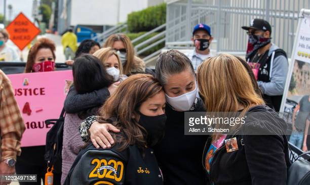 Family, friends and supporters of Monique Munoz embrace and protest outside the Inglewood Juvenile Courthouse where the teen son of a wealthy L.A....