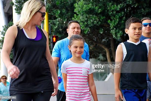Family Friends walking in Urban Scene