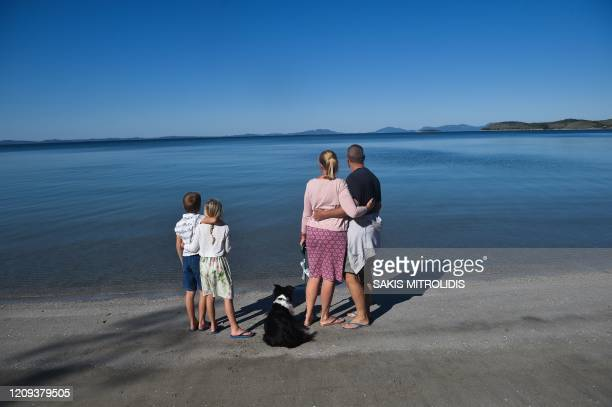 Family from England watch the sea in a camping at Igoumenitsa, western Greece on April 8, 2020. - Near the port of Igoumenitsa, in a campsite...