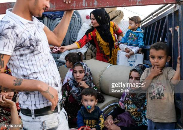 Family from Qamishli, Syria arrives at Badarash IDPs camp which has continued to swell for Syrian Kurdish refugees fleeing the recent Turkish...
