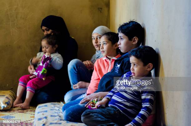A family from Syria in a refugee camp close to the Southern border is portrayed The mother wearing a black veil sitting on the corner of an empty...