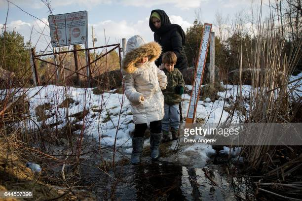 A family from Turkey crosses the USCanada border into Canada February 23 2017 in Hemmingford Quebec In the past month hundreds of people have crossed...