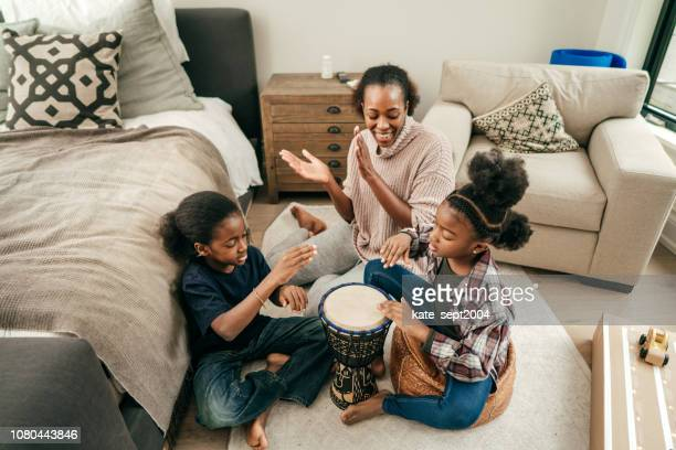 family fun at home - percussion instrument stock photos and pictures