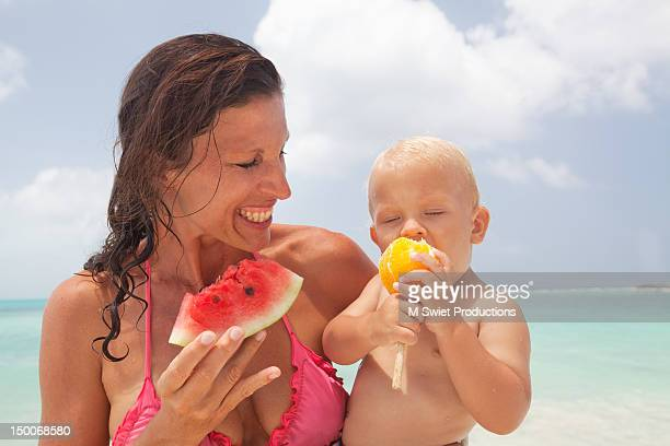 family fun beach - mexican and white baby stock photos and pictures