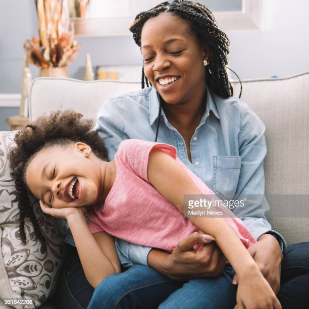 """family fun on the couch - """"marilyn nieves"""" stock pictures, royalty-free photos & images"""