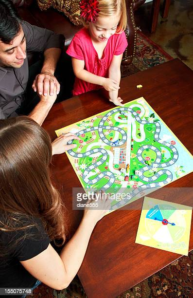 family game night - game night stock photos and pictures