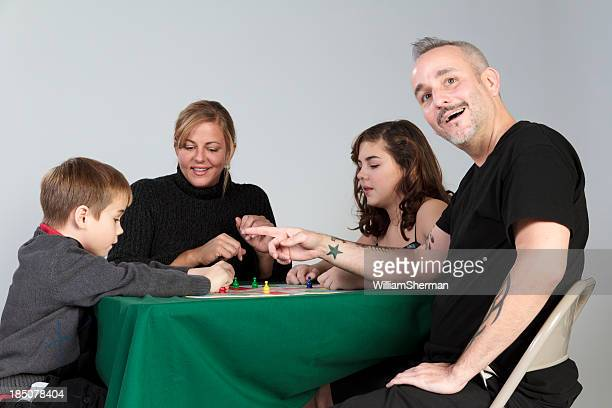 family game night -- surprise move - game night stock photos and pictures