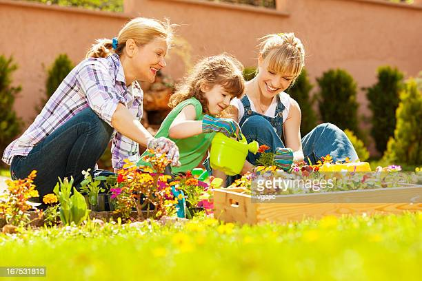 family gardening together outdoors - flower head stock photos and pictures