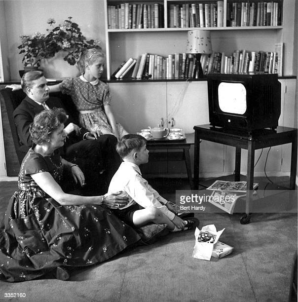 A family gather round the television for an evening's entertainment