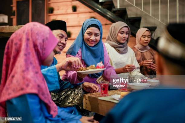family gathering and eat together - eid mubarak stock pictures, royalty-free photos & images