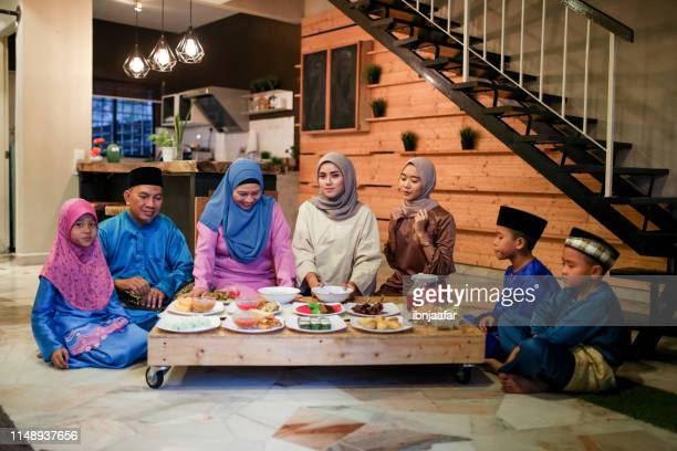 family gathering and eat together - iftar stock pictures, royalty-free photos & images