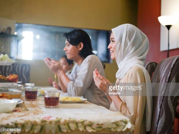 family gathering and eating together - ramadan stock pictures, royalty-free photos & images