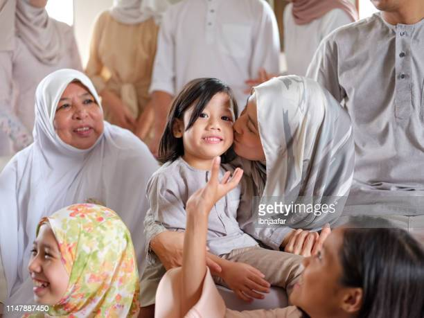 family gathering and laughing - eid ul fitr photos stock pictures, royalty-free photos & images