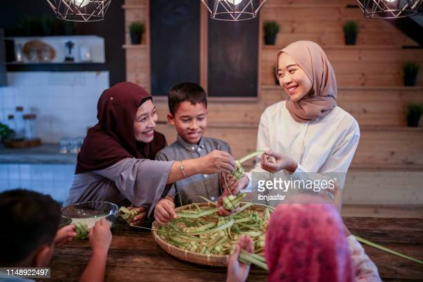 family gathering and preparing food - eid ul fitr stock pictures, royalty-free photos & images