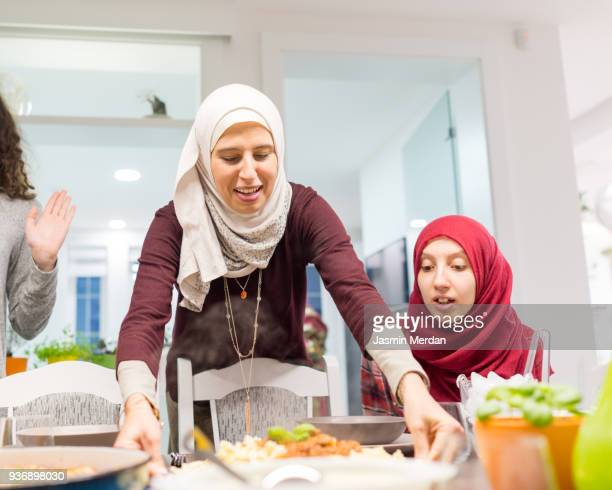 family gathering for dinner together - iftar stock pictures, royalty-free photos & images