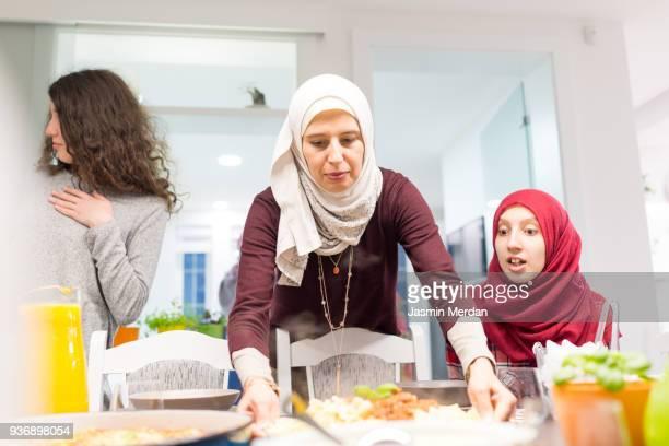 family gathering for dinner together - iftar stock-fotos und bilder