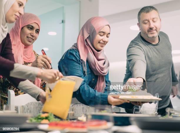 family gathering in ramadan - eid mubarak stock pictures, royalty-free photos & images