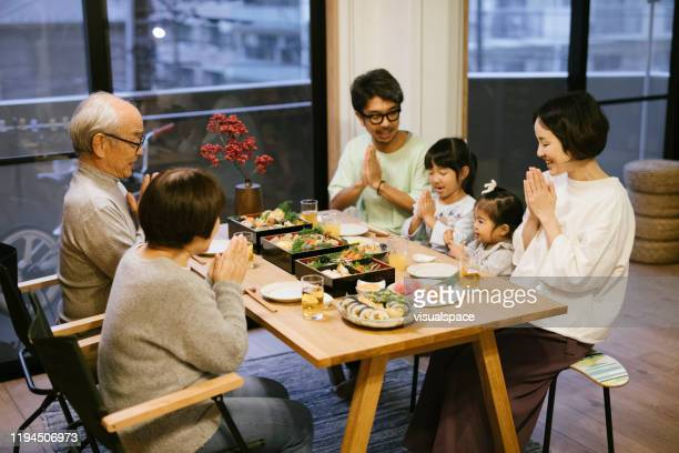 family gathering on new year's day - new year's day stock pictures, royalty-free photos & images