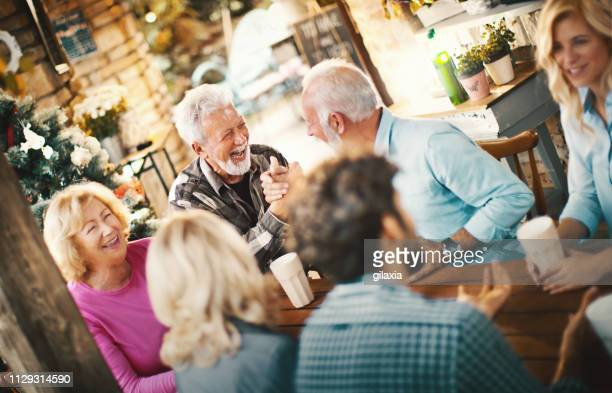 family gathering. - social gathering stock pictures, royalty-free photos & images