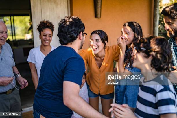 family gathering - greeting stock pictures, royalty-free photos & images
