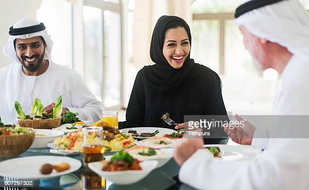 family gathering, three generations eating traditional food. - arabia stock pictures, royalty-free photos & images