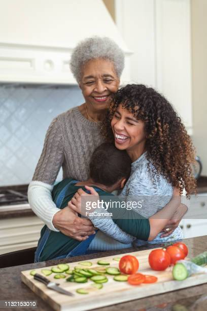family generations cooking together - fat granny stock pictures, royalty-free photos & images