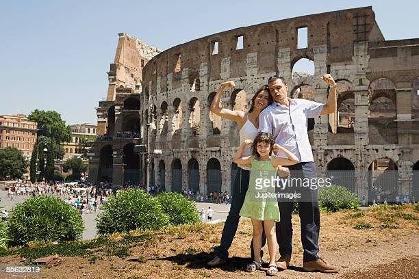Family gesturing,  Roman Colosseum,  Rome,  Italy