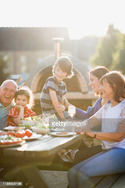 family get together - restaurant stock pictures, royalty-free photos & images