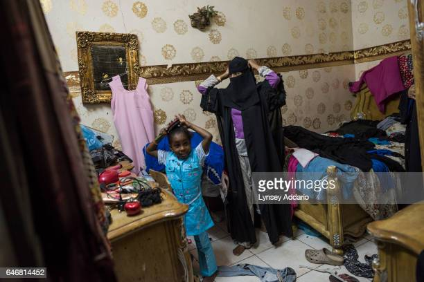 A family gets dressed before a party at home in Riyadh Saudi Arabia March 20 2015