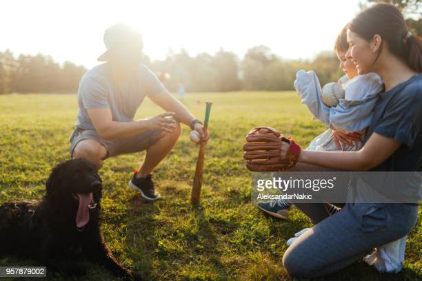 family getting ready for a softball game - baseball mom stock pictures, royalty-free photos & images