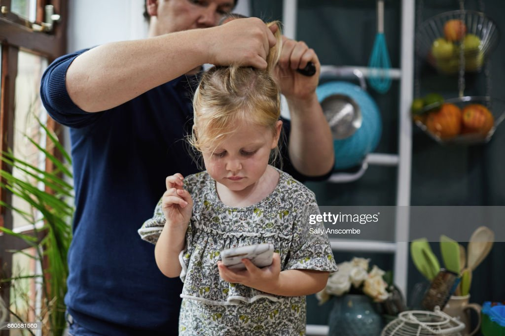 Family getting ready for school in the morning : Stock Photo