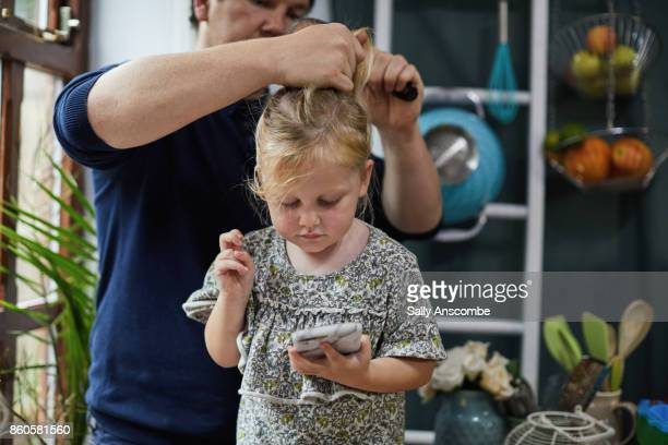 family getting ready for school in the morning - gender bender foto e immagini stock