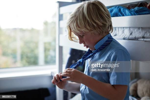 family getting ready for school in the morning - schuluniform stock-fotos und bilder
